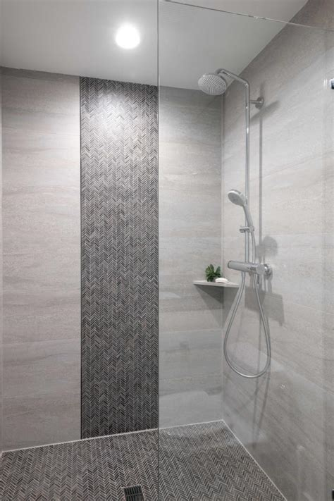 walk  shower  herringbone mosaic tile hgtv