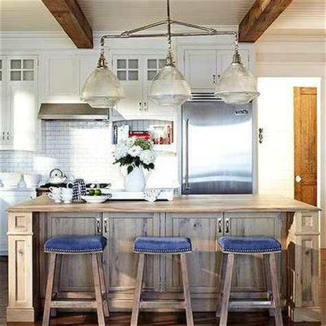 ivory kitchen island  blue nailhead counter stools