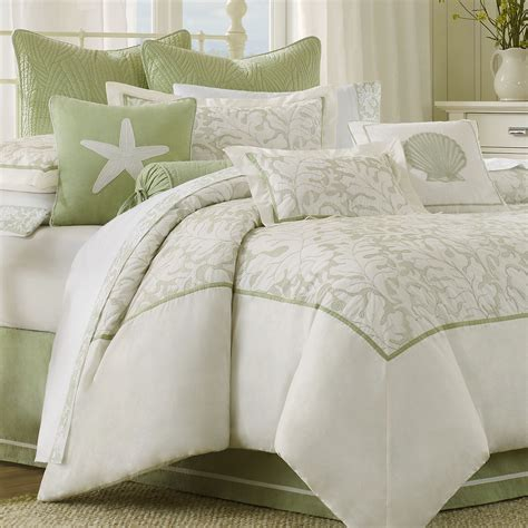 white bedroom bedding set with floral pattern and green