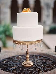 white wedding cake on gold cake stand