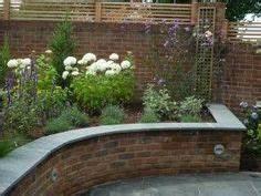 Raised brick garden bed tucks away in a corner The curve