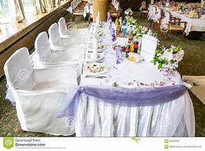 White Wedding Party Table With Fancy Chairs And A Lot Of