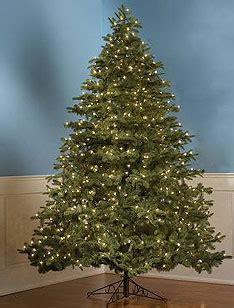 slim pre lit christmas trees santa claus and christmas