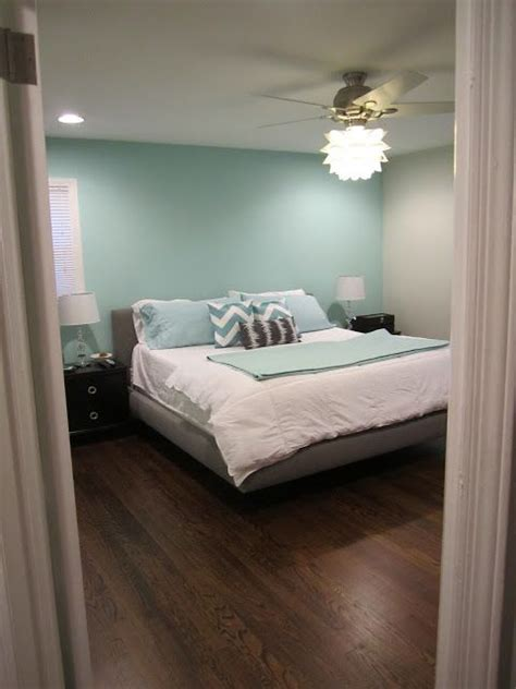 aqua accent wall with grey and that fan light home