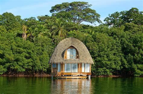 Tropical Bungalow Over Water Thatched Roof Stock Photo
