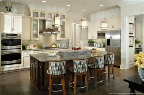 lighting above kitchen island when hanging pendant lights over a kitchen island like these progresslighting quot bay court quot one
