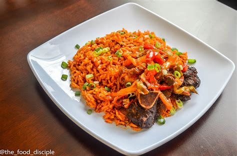 jollof rice and peppered beef the food disciple
