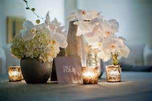 contemporary wedding modern wedding reception decor white orchids centerpieces onewed