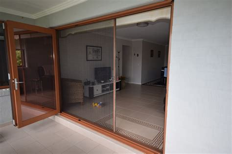 retractable screens for all doors shut out the insects
