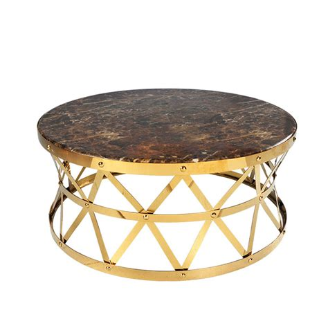 This wonderful coffee table features beautiful rose gold stainless steel legs for strength, while the color contrasts nicely with the amazing back and white genuine marble top surface. Rose Gold Round Coffee Table with Rattan Style Base - Filo Furniture