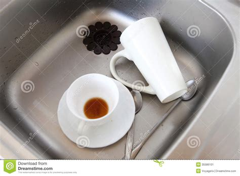kitchen faucet prices dishwashing white dishes in the kitchen sink stock image