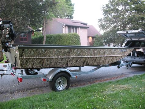 Toy Duck Hunting Boat by 16 Ft Duck Boat Covered With Total Camo S Mixed Reed Self