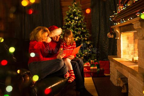 Happy Family Reading Christmas Book Sitting On Stock Photo Snake Found In Bathtub Cost Of Replacement How To Repair Drain Plug Airstone Makeover Reglazing Dallas Tx Beach Web Best Rated Acrylic Bathtubs Safety Seat For Babies
