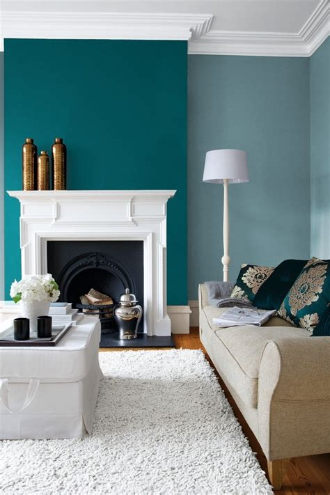 dishy turquoise paint color  orange upholstered headboard