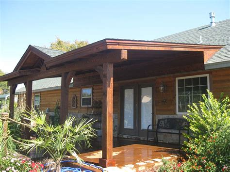 roofed backyard patio cover with sunburst hundt patio