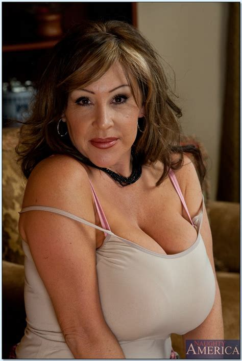 Busty Mature Lady Kandi Cox Playing With Her Huge Boobs In