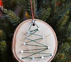 Bild Mit Nägeln Und Faden : bastel idee mit einer holzscheibe n geln und faden basteln weihnachtsbaumschmuck basteln ~ Frokenaadalensverden.com Haus und Dekorationen