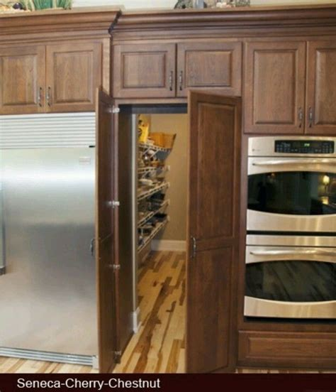 pantry storage cabinets with doors door leading to pantry in middle of kitchen cabinets