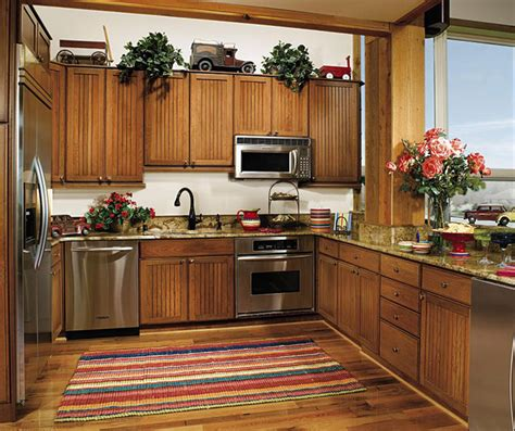 country beadboard kitchen cabinets beadboard cabinets in rustic kitchen decora cabinetry