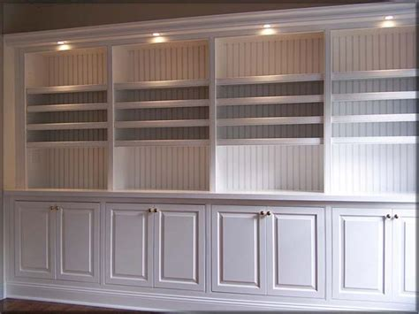 Built In Bookcases  Beadboard Back And Down Lights