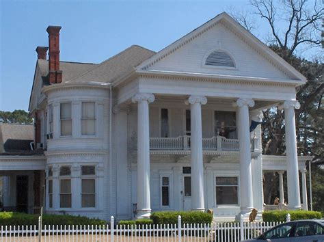 revival style architecture house with pillars