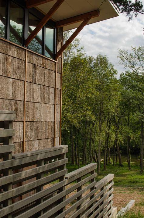 river connects  camusrory bark shingle siding bark house