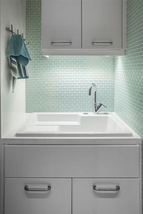 mint green tiles contemporary laundry room id interiors