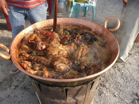 cooking carnitas   antique copper kettle mexican