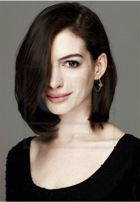 Get into those long, feathered bangs! Anne Hathaway Hairstyle Natural brown short bob hair wigs ...