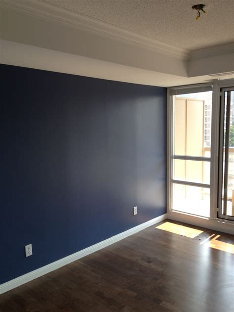 nice blue feature wall  toronto  blank haus blue feature wall wall empty room
