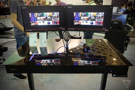 this motorized standing desk is actually a gaming pc the