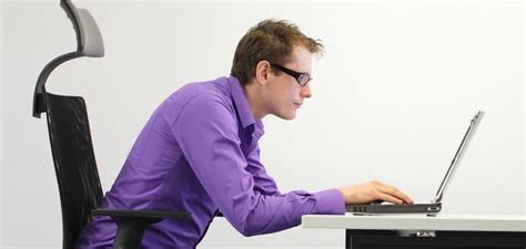back pain from sitting at desk ergonomics explained are sitting or standing desks better