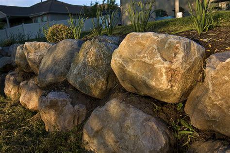 boulder retaining wall green scene specializes in boulder walls for minnesota homesgreen scene landscaping tree care