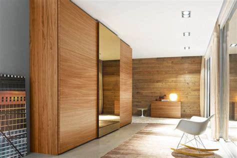 luxury bedroom  brown wood sliding closet doors