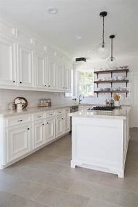 beautiful kitchen features white cabinets paired with taj With kitchen cabinet trends 2018 combined with board game wall art