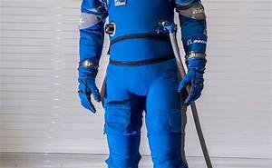 Boeing Unveils Blue Spacesuits for Starliner Crew Capsule ...