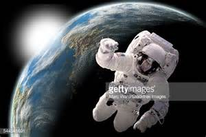 Astronaut Floating In Outer Space With Visible Sunrise ...