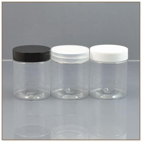 small plastic jars  lids