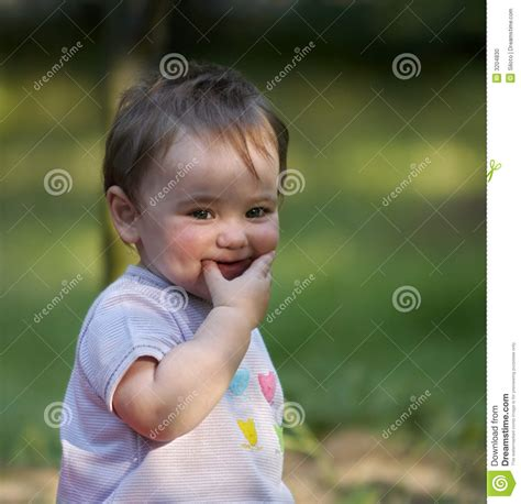 Furtive smile stock photo. Image of infant, laugh, baby ...