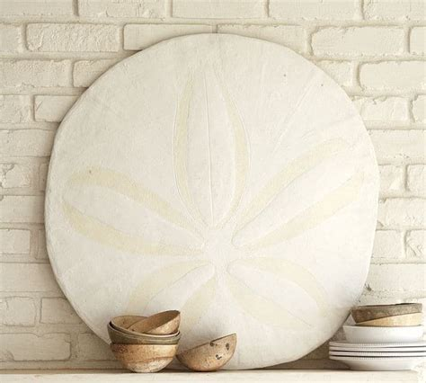 This decorative sand dollar piece was sculpted in stone by a friend of mount this fish company and we now have it available as a superior nautically themed fiberglass decorative wall reproduction. Oversized Sand Dollar