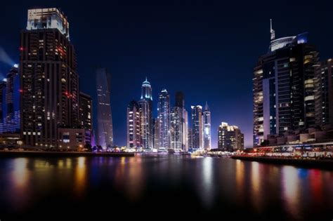 city cityscape night dubai united arab emirates water