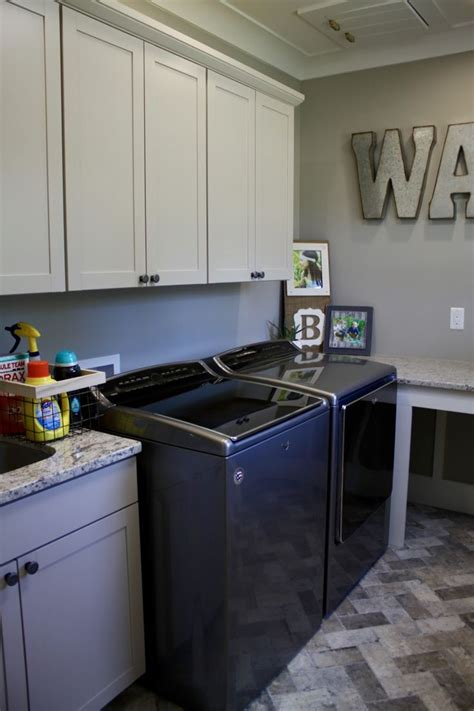 laundry room designed  tina holland  aristokraft