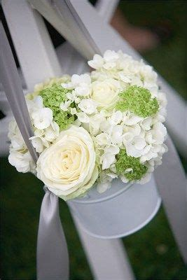 Fill small tin buckets with wedding flowers to decorate