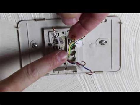 service manual how to replace a thermostat in how to replace an old thermostat by home repair tutor youtube