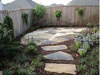 best corner patio design ideas Here a secondary outdoor living area has been created in yard corner via the flagstone path off ...