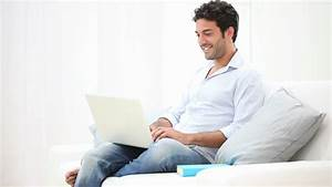Young Man With Notebook Typing Something And Smiling Stock ...