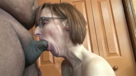 Red Haired Milf In Glasses Sucks A Small Cock Indoors
