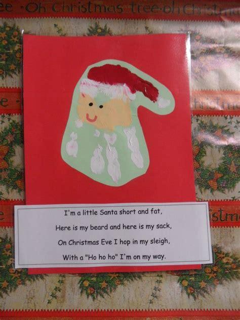 handprint santa  poemcan   peach paper