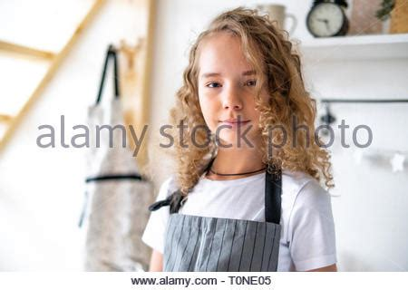 Young cute curly girl preparing breakfast for parents and