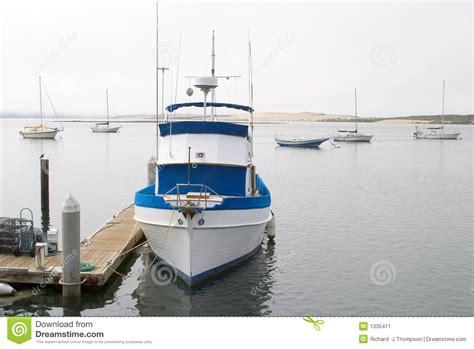 Small But Powerful Boat by Fishing Boat At Dock Stock Image Image 1335411